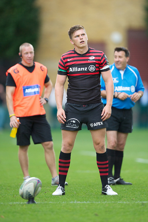 20120823 Copyright onEdition 2012©.Free for editorial use image, please credit: onEdition..Owen Farrell of Saracens prepares to take a penalty kick at The Honourable Artillery Company, London in the pre-season friendly between Saracens and Stade Francais Paris...For press contacts contact: Sam Feasey at brandRapport on M: +44 (0)7717 757114 E: SFeasey@brand-rapport.com..If you require a higher resolution image or you have any other onEdition photographic enquiries, please contact onEdition on 0845 900 2 900 or email info@onEdition.com.This image is copyright the onEdition 2012©..This image has been supplied by onEdition and must be credited onEdition. The author is asserting his full Moral rights in relation to the publication of this image. Rights for onward transmission of any image or file is not granted or implied. Changing or deleting Copyright information is illegal as specified in the Copyright, Design and Patents Act 1988. If you are in any way unsure of your right to publish this image please contact onEdition on 0845 900 2 900 or email info@onEdition.com