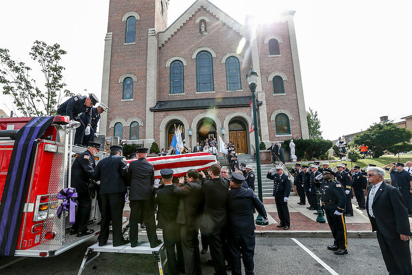 Dozens of first responders stand at attention as the flag-draped casket containing the remains of Manasquan volunteer firefighter Dan McCann is carried out of St. Cecilia's Church in Kearny after McCann's funeral mass. McCann, a firefighter EMT with more than 25 years experience, died last week after a fire department training exercise.  9/21/16  (Andrew Mills   NJ Advance Media for NJ.com)