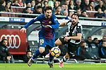 Lionel Andres Messi (L) of FC Barcelona fights for the ball with Ivan Lopez Alvarez, Ivi, of Levante UD during the La Liga 2017-18 match between FC Barcelona and Levante UD at Camp Nou on 07 January 2018 in Barcelona, Spain. Photo by Vicens Gimenez / Power Sport Images