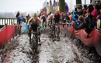 Tom Meeusen (BEL/Telenet-Fidea) leads the bunch through the trenches in pursuit of the 2 young leaders<br /> <br /> Azencross Loenhout 2014