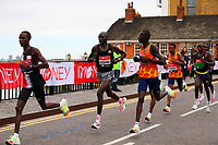 3rd October 2021; London, England: The Virgin Money 2021 London Marathon: Leading group of elite men runners with Vincent Kipchumba  of Kenya and Titus Ekiru of Kenya in the front crossing Narrow Street Swing Bridge, Limehouse Basin between mile 14 and 15.