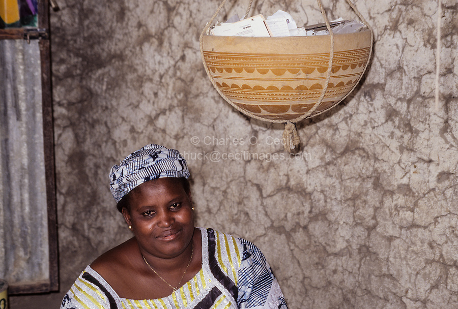 Nigerien Woman in her Room with Calabash for Storing Papers, Ouna, Niger.