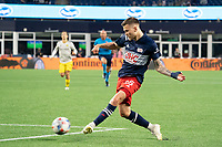 FOXBOROUGH, MA - MAY 16: Amor Traustason #25 of New England Revolution shoots at the Columbus SC goal during a game between Columbus SC and New England Revolution at Gillette Stadium on May 16, 2021 in Foxborough, Massachusetts.