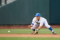 UCLA shortstop Pat Valaika (10) fields a ground ball during Game 12 of the 2013 Men's College World Series against the North Carolina Tar Heels on June 21, 2013 at TD Ameritrade Park in Omaha, Nebraska. The Bruins defeated the Tar Heels 4-1, to reach the CWS Final and eliminate North Carolina from the tournament. (Andrew Woolley/Four Seam Images)