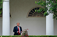 United States President Donald J. Trump adjusts his jacket while standing in the Colonnade of the White House after a Rolling to Remember ceremony honoring the nation's veterans and prisoners of war/missing in action (POW/MIA) in Washington, D.C., U.S., on Friday, May 22, 2020. Trump didn't wear a face mask during most of his tour of Ford Motor Co.'s ventilator facility Thursday, defying the automaker's policies and seeking to portray an image of normalcy even as American coronavirus deaths approach 100,000. <br /> Credit: Andrew Harrer / Pool via CNP/AdMedia