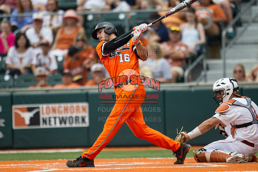 Oklahoma State Cowboys first baseman Tanner Krietemeier #16 follows through on his swing during the NCAA baseball game against the Texas Longhorns on April 26, 2014 at UFCU Disch–Falk Field in Austin, Texas. The Cowboys defeated the Longhorns 2-1. (Andrew Woolley/Four Seam Images)