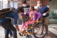 "The Nepali volunteers from ""I to WE"" help Ramaya Thapa, a victim of Nepal earthquake, helps to admit in the hospital in Kathmandu, Nepal. May 05, 2015"