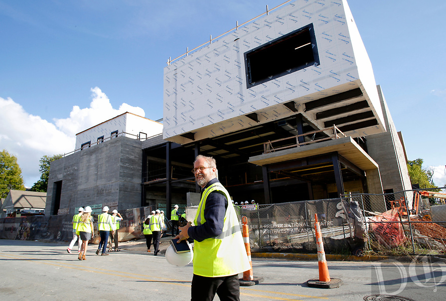 NWA Democrat-Gazette/DAVID GOTTSCHALK Jonathan Marvel, with Marvel Architects, Monday, watches as guests enter Monday, October 1, 2018, the new TheatreSquared building in Fayetteville. City officials and guests toured the building that is under construction to see the progress of the facility that will house two theaters and other amenities.