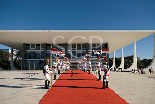 Brasilia, Brazil. Guards outside the Supreme Court with red carpet for a State visit.