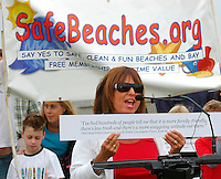 OB Resident and business owner Julie Kline speaks at a rally and press confernence held by the pro-alocohol-ban group Safe Beaches in Mission Beach Thursday, July 3rd 2008.  Residents, business owners and a Real Estate agent took turns to speak about the alcohol ban and the positive impact they feel it has had on the area while supporters stood behind them holding quotations lauding the ban that had been printed on large cards and distributed before the rally began.
