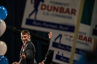 Forrest Dunbar, the Democratic challenger for Alaska's congressional seat, gives a thumbs-up to supporters as polls show him trailing Republican incumbent Don Young at Election Central in the Egan Center Nov. 4.