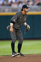 Vanderbilt Commodores shortstop Dansby Swanson (7) on defense during the NCAA College baseball World Series against the Cal State Fullerton Titans on June 14, 2015 at TD Ameritrade Park in Omaha, Nebraska. The Titans were leading 3-0 in the bottom of the sixth inning when the game was suspended by rain. (Andrew Woolley/Four Seam Images)