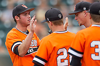 Oklahoma State Cowboys pitcher Alex Hackerott #39 is greeted by his teammates after being removed from the NCAA baseball game against the Texas Longhorns on April 26, 2014 at UFCU Disch–Falk Field in Austin, Texas. The Cowboys defeated the Longhorns 2-1. (Andrew Woolley/Four Seam Images)