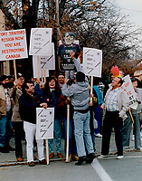 1990 FILE PHOTO - ARCHIVES -<br /> <br /> Tax protest: A demonstrator attacks an effigy of Prime Minister Brian Mulroney at a protest against the GST yesterday at the offices of Finance Minster Michael Wilson.<br /> <br /> 1990<br /> <br /> PHOTO :  Erin Comb - Toronto Star Archives - AQP