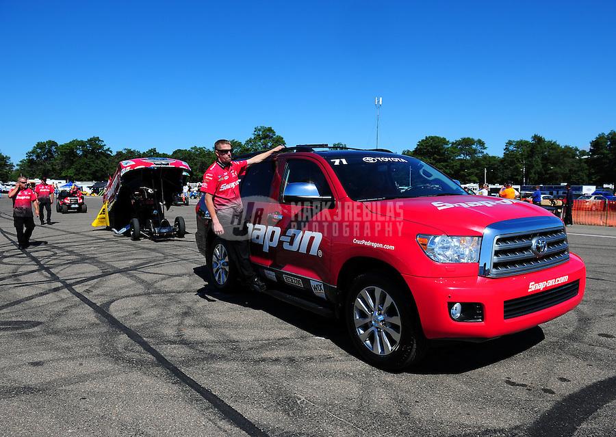 Aug. 21, 2011; Brainerd, MN, USA: NHRA crew members for funny car driver Cruz Pedregon during the Lucas Oil Nationals at Brainerd International Raceway. Mandatory Credit: Mark J. Rebilas-US