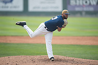 Helena Brewers relief pitcher Roberto Delgado (43) follows through on his delivery during a Pioneer League game against the Grand Junction Rockies at Kindrick Legion Field on August 19, 2018 in Helena, Montana. The Grand Junction Rockies defeated the Helena Brewers by a score of 6-1. (Zachary Lucy/Four Seam Images)