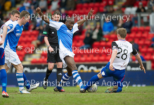 St Johnstone v Inverness Caley Thistle.....27.04.13      SPL.Gregory Tade is tackled by Charles Taylor.Picture by Graeme Hart..Copyright Perthshire Picture Agency.Tel: 01738 623350  Mobile: 07990 594431