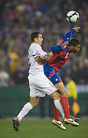 Carlos Bocanegra heads the ball against Costa Rica's Dennis Marshall during a 2-2 tie with Costa Rica to put the USA in first place of .CONCACAF 2010 World Cup qualifying, at RFK Stadium, in Washington DC, Wednesday, October 14, 2009.