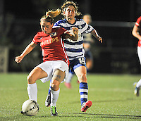 20130906 - OOSTAKKER , BELGIUM : Gent's captain Elke Van de Sompel (right) pictured pushing PSV's  Marlou Kelleners (left) during the female soccer match between AA Gent Ladies  and PSV / FC Eindhoven Dames , of the third matchday in the BENELEAGUE competition. Friday 06 th September 2013. PHOTO DAVID CATRY