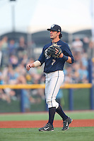 First overall draft pick in the 2015 Major League Baseball Player Draft, Dansby Swanson (7) of the Hillsboro Hops heads to the mound to talk with the pitcher during a game against the Boise Hawks at Ron Tonkin Field on August 22, 2015 in Hillsboro, Oregon. Boise defeated Hillsboro, 6-4. (Larry Goren/Four Seam Images)