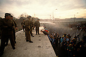 West Berlin, West Germany<br /> November 11, 1989<br /> <br /> East German police spray water on people climbing onto the Berlin Wall at the Brandenburg Gate. The East German government lifts travel and emigration restrictions to the West on November 9, 1989.