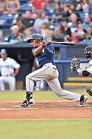 Columbia Fireflies center fielder Enmanuel Zabala (9) swings at a pitch during a game against the Asheville Tourists at McCormick Field on August 17, 2016 in Asheville, North Carolina. The Tourists defeated the Fireflies 7-6. (Tony Farlow/Four Seam Images)