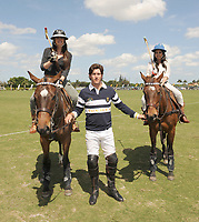 WEST PALM BEACH, FL - MARCH 14:  Kourtney Kardashian and Scott Disick with their young son Mason Dash Disick in tow take a polo lesson with top ranked american polo player Nic Roldan. The couple was joined by sister Khloe Kardashian. The kardashian clan had a great afternoon, riding horses and joking around while they sipped champagne at the International polo club palm beach on March 14, 2010 in Wellington, Florida.  <br /> <br /> People: Khloe Kardashian_Nic Roldan_Kourtney Kardashian