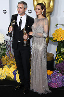 HOLLYWOOD, LOS ANGELES, CA, USA - MARCH 02: Alfonso Cuaron, Angelina Jolie at the 86th Annual Academy Awards - Press Room held at Dolby Theatre on March 2, 2014 in Hollywood, Los Angeles, California, United States. (Photo by Xavier Collin/Celebrity Monitor)