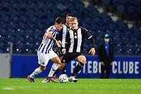 20th December 2020; Dragao Stadium, Porto, Portugal; Portuguese Championship 2020/2021, FC Porto versus Nacional; Otávio of FC Porto holds off Vladan Danilovic of Nacional