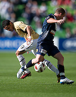 MELBOURNE, AUSTRALIA - DECEMBER 27: Leigh Broxham of the Victory and Ali Abbas of the Jets compete for the ball during the round 20 A-League match between the Melbourne Victory and the Newcastle Jets at AAMI Park on December 27, 2010 in Melbourne, Australia. (Photo by Sydney Low / Asterisk Images)