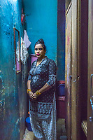India, Maharashtra, Mumbai, Bombay, red light district. Woman sex-worker, prostitute, on Falkland road applying makeup as she prepares for work for the evening. Although illegal under Indian law, there are over six million vctims of sex trafficking in the country.