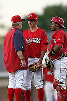 Batavia Muckdogs pitcher Zach Russell (25) talks with catcher Audry Perez (4) and pitching coach Ace Adams during a game vs. the Auburn Doubledays at Dwyer Stadium in Batavia, New York July 2, 2010.   Batavia defeated Auburn 6-3.  Photo By Mike Janes/Four Seam Images