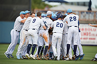 Charlotte Stone Crabs Moises Gomez (21) is mobbed by teammates after hitting a walk-off single during a Florida State League game against the Dunedin Blue Jays on April 17, 2019 at Charlotte Sports Park in Port Charlotte, Florida.  Charlotte defeated Dunedin 4-3.  (Mike Janes/Four Seam Images)
