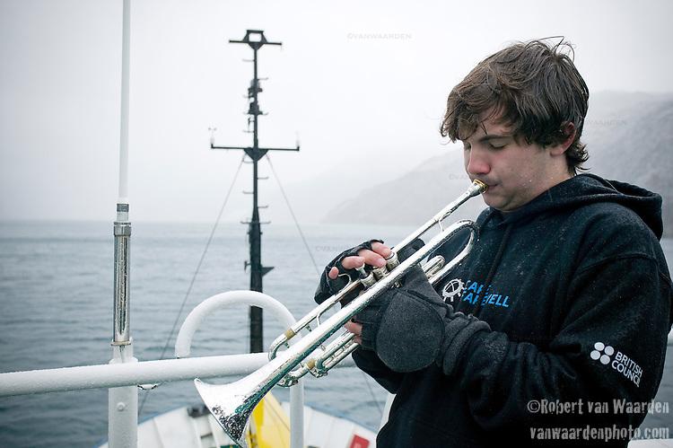 Sean serenades the Prins Christian Sound.