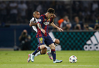 Calcio, finale di Champions League Juventus vs Barcellona all'Olympiastadion di Berlino, 6 giugno 2015.<br /> FC Barcelona's Lionel Messi, right, is challenged by Juventus' Arturo Vidal during the Champions League football final between Juventus Turin and FC Barcelona, at Berlin's Olympiastadion, 6 June 2015.<br /> UPDATE IMAGES PRESS/Isabella Bonotto
