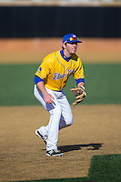 Delaware Blue Hens third baseman Diaz Nardo (27) on defense against the Georgetown Hoyas at Wake Forest Baseball Park on February 13, 2015 in Winston-Salem, North Carolina.  The Blue Hens defeated the Hoyas 3-0.  (Brian Westerholt/Four Seam Images)