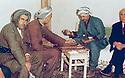 Iraq 1963 .Kurdes in Koysanjak playing trictrac; left, Hajar Sharafkandi, the writer.Irak 1963.Kurdes jouant au trictrac a Koysanjak; a gauche, l'ecrivain Hajar Sharafkandi