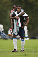 A East London League Sunday footballer is seen carrying his injured team mate on Hackney Marshes - 19/10/08 - MANDATORY CREDIT: Gavin Ellis/TGSPHOTO - Self billing applies where appropriate - Tel: 0845 094 6026