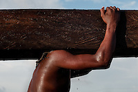 A Colombian sawmill worker carries a lumber from the Pacific rainforest in Tumaco, Colombia, 15 June 2010. Tens of sawmills located on the banks of the Pacific jungle rivers generate almost half of the Colombia's wood production. The wood species processed here (sajo, machare, roble, guabo, cargadero y pacora) are mostly used in the construction industry and the paper production. Although the Pacific lush rainforest in Colombia is one of the most biodiverse area of the world, the region suffers an extensive deforestation due to the uncontrolled logging in the last years.