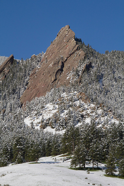 First Flatiron and Spring snowstorm in Boulder, Colorado, USA. John leads private photo tours in Boulder, Denver and Rocky Mountain National Park, Year-round.