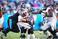 CHARLOTTE, NC - NOVEMBER 17: Dontari Poe #95 of the Carolina Panthers sacks Younghoe Koo #7 of the Atlanta Falcons during a game between Atlanta Falcons and Carolina Panthers at Bank of America Stadium on November 17, 2019 in Charlotte, North Carolina.