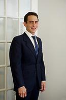 Standing executive portrait three quarter length.
