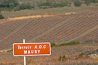 Terroir AOC Maury. Sign in focus and vineyard out of focus. Maury. Roussillon. France. Europe.