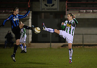 20131213 - VARSENARE , BELGIUM : Brugge's Heleen Jaques (left) pictured in a duel with Zwolle's Sylvia Smit during the female soccer match between Club Brugge Vrouwen and PEC Zwolle Ladies , of  matchday 14  in the BENELEAGUE competition. Friday 13th December 2013. PHOTO DAVID CATRY