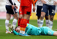 20th March 2021; Deepdale Stadium, Preston, Lancashire, England; English Football League Championship Football, Preston North End versus Luton Town; Luton Town goalkeeper Simon Sluga reacts after his collision with team mate Matty Pearson and Ched Evans of Preston North End