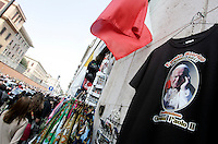 Ritratti, cartoline e gadgets raffiguranti Papa Giovanni Paolo II, in vendita nel rione Borgo, Roma, 17 aprile 2011, in vista della cerimonia di beatificazione prevista il 1 maggio..Portraits, postcards and gadgets of Pope John Paul II are displayed at window shops around the Vatican in Rome, 17 april 2011, in sight of the beatification ceremony scheduled on 1st May. .UPDATE IMAGES PRESS/Riccardo De Luca