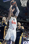 Real Madrid's Gustavo Ayon (c) and Alba Berlin's Niels Giffey (l) and Alex King during Euroleague match.March 12,2015. (ALTERPHOTOS/Acero)