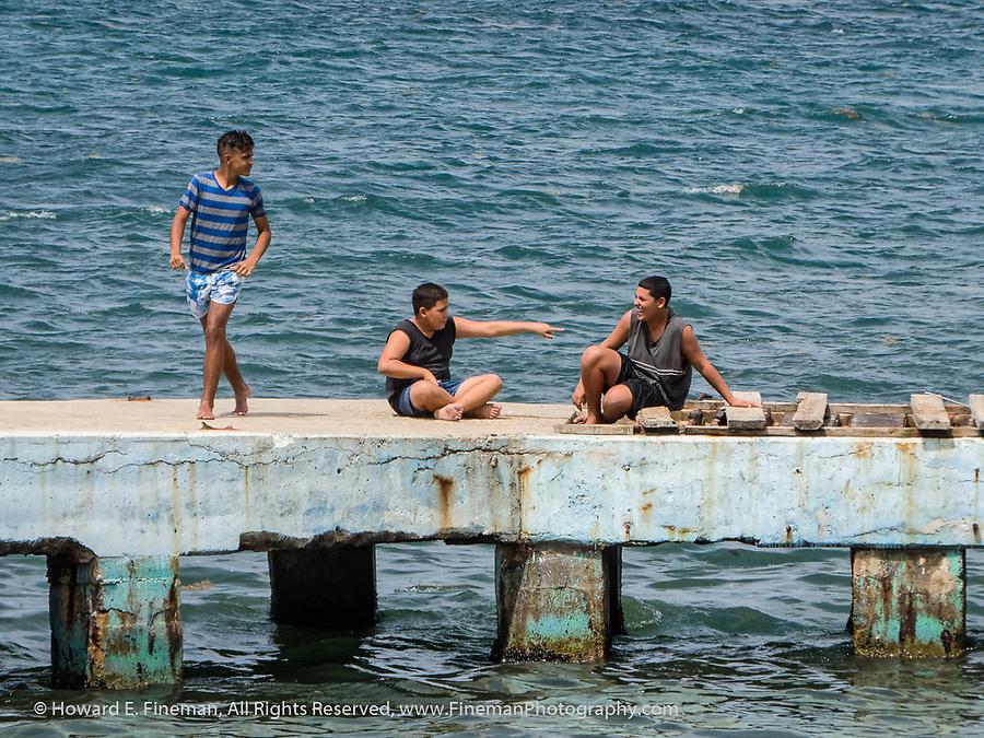 Cuban boys swimming near Cojimar seawall