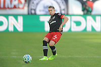 WASHINGTON, DC - MARCH 07: Russell Canouse #4 of D.C. United moves the ball during a game between Inter Miami CF and D.C. United at Audi Field on March 07, 2020 in Washington, DC.