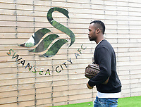 Swansea City's Jordan Ayew arrives for his first day back for the new season.
